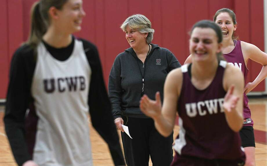 Mary Ellen Burt, center, who is the women's head basketball coach and head golf coach at Union College shares a laugh with her basketball team during practice at the college on Thursday, Jan. 12, 2017 in Schenectady, N.Y. (Lori Van Buren / Times Union) Photo: Lori Van Buren / 20039417A