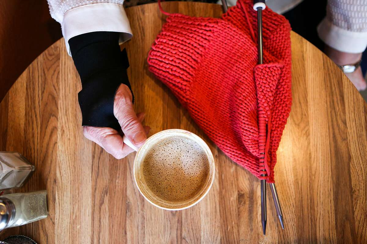 Beverly Edmonds takes a coffee break while she works on finishing her remaining orders for friends and family as part of the Pussyhat Project on Tuesday, January 17, 2017 in Benicia, Calif. Edmonds has been knitting so much in the last few weeks to keep up with orders for the Pussycats that she has to now wear a wrist brace.