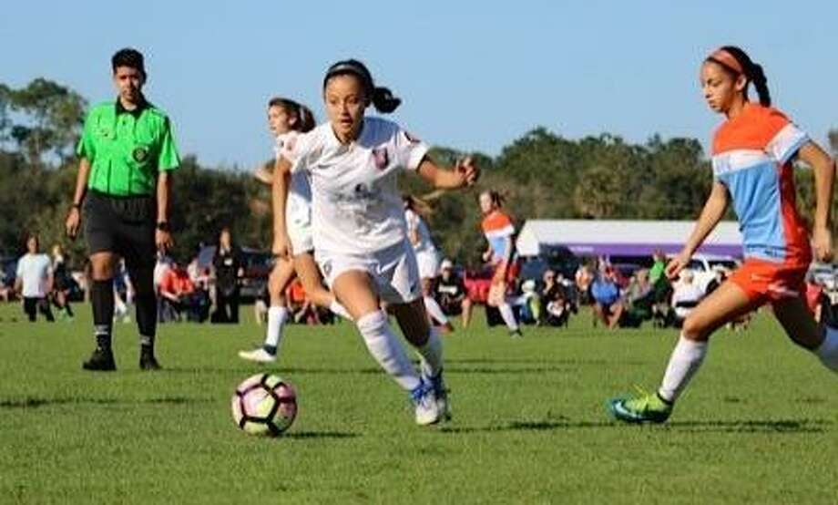 San Antonio's Jillian Martinez (with ball) in action as a member of the USA girls under-15 national team. Photo: Courtesy Photo /Martinez Family