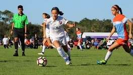 San Antonio's Jillian Martinez (with ball) in action as a member of the USA girls under-15 national team.