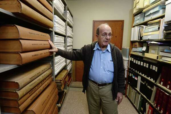 Norwalk historian Ralph Bloom points out valuable material in the Norwalk Library Main Branch's History Center Tuesday, January 17, 2017, following the flooding that closed the branch last Thursday and damaged material in the Center in Norwalk, Conn. Although the branch reopened on Friday the History Center will not be open for another 10 days. due to the fact that material is still damp and fans are set up drying the space after a water pipe broke in the ceiling of the top floor sending water downward in the building.