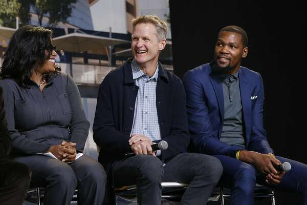 Thasunda Duckett, Chase consumer banking chief executive officer, Warriors' head coach Steve Kerr and Warriors' Kevin Durant share a laugh as the NBA Golden State Warriors hold a ground breaking ceremony for Chase Center, the state-of-the-art sports and entertainment complex in San Francisco, Ca., on Tuesday Jan. 17, 2017.