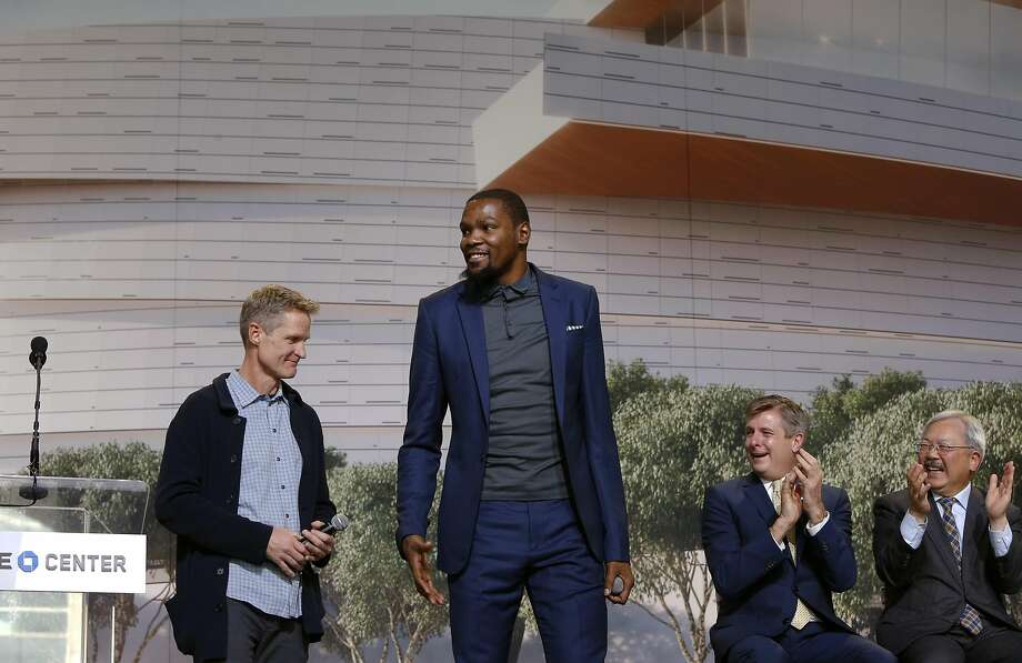 Warriors' head coach Steve Kerr and Warriors' Kevin Durant gets applauds from �Rick Welts, Warriors' President & COO and San Francisco Mayor Ed Lee as the NBA Golden State Warriors hold a ground breaking ceremony for�Chase�Center, the state-of-the-art sports and entertainment complex in San Francisco, Ca., on Tuesday Jan. 17, 2017. Photo: Michael Macor, The Chronicle