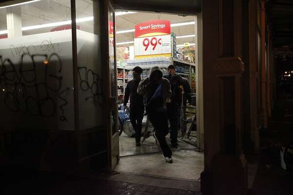 Vandals loot the grocery store Smart and Final after vandalizing the front and breaking the windows during a protest against the grand jury's decision not to indict the white police officer who fatally shot an unarmed black teenager months ago in Ferguson Nov. 24, 2014 in Oakland, Calif.