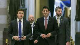 House Speaker Paul Ryan (R-Wis.) walks through Statuary Hall towards the House floor for a vote, at the Capitol building in Washington, Jan. 13. The House joined the Senate on Friday in moving speedily to repeal the Affordable Care Act, approving the Senate budget blueprint that would allow Republicans to act without the prospect of a filibuster.