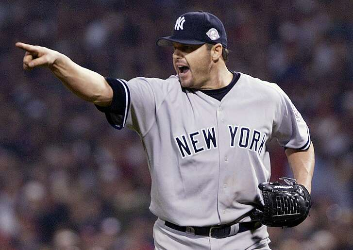 New York Yankees' Roger Clemens points at teammates after getting out of a jam in the sixth inning of Game 3 of the American League Championship Series against the Boston Red Sox Saturday, Oct. 11, 2003, at Fenway Park in Boston. (AP Photo/Al Behrman)