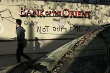 Graffiti is seen on the Bank of the Orient on Webster. St. following overnight protests against the election of Donald Trump, in Oakland, CA, Thursday, November 10, 2016.