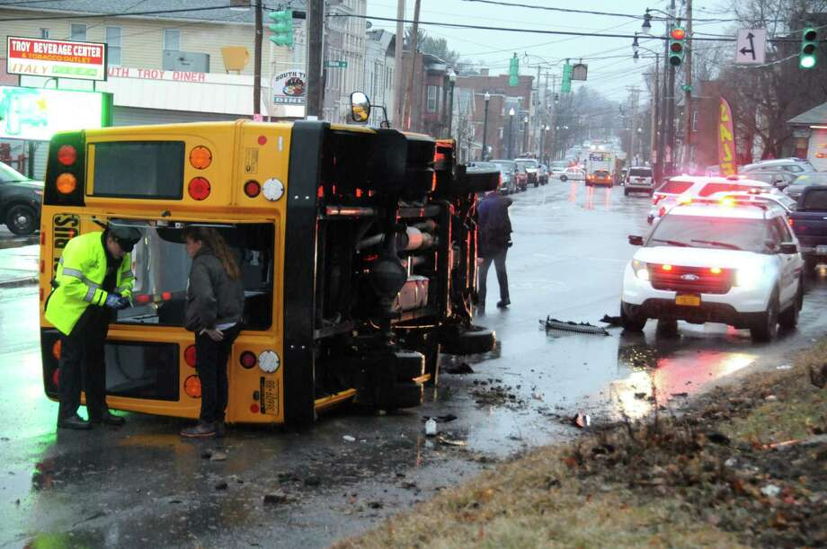 One student was taken to the hospital with an arm injury after the bus he was in slipped on an icy Troy road and flipped on its side. (Brian.L.Houle / I.P.A)