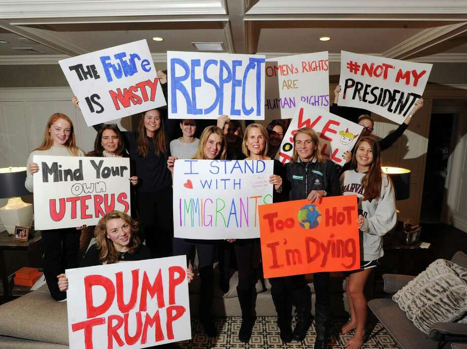 Karen Giannuzzi, at center left and Mary Himes, center right, stand along with other women displaying the posters they made to be used during the March on Washington at Giannuzzi's home in Greenwich, Conn., Wednesday, Jan. 11, 2017. The Women's March on Washington, according to the event website, is a rally and march to call attention to the new Trump administration on their first day in office that women's rights are human rights. It will take place Saturday, 10 a.m., Jan. 21, in Washington, D.C. Photo: Bob Luckey Jr. / Hearst Connecticut Media / Greenwich Time