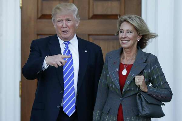 President-elect Donald Trump stands with Education Secretary-designate Betsy DeVos in Bedminster, N.J. on Nov. 19, 2016. DeVos has spent over two decades advocating for school choice programs, which give students and parents an alternative to traditional public school education.