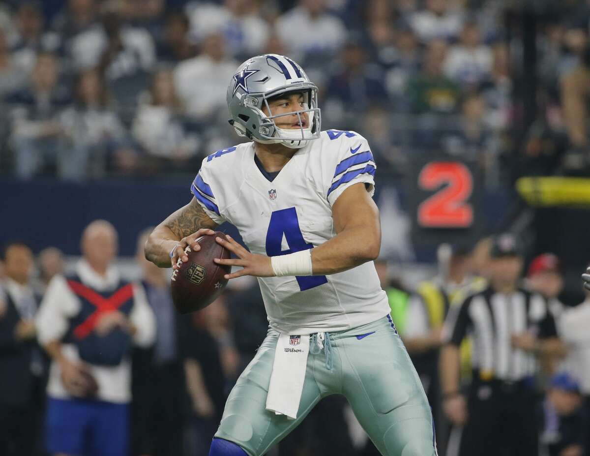 Dallas Cowboys' Dak Prescott throws during the first half of an NFL divisional playoff football game against the Green Bay Packers Sunday, Jan. 15, 2017, in Arlington, Texas. (AP Photo/Tony Gutierrez)