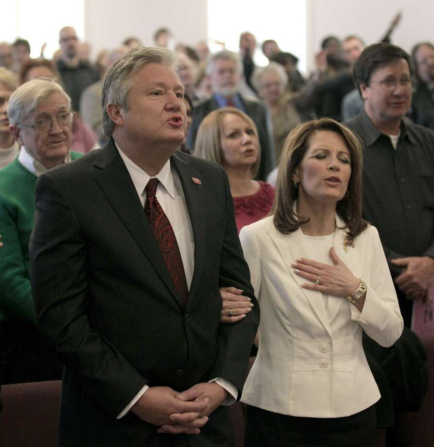 Republican presidential candidate, Rep. Michele Bachmann, R-Minn., and her husband Marcus attend services at Jubilee Family Church in Oskaloosa, Iowa, Sunday, Jan, 1, 2012. (AP Photo/Charlie Riedel) Photo: Charlie Riedel, Associated Press
