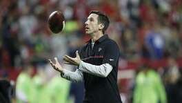Atlanta Falcons Offensive Coordinator Kyle Shanahan warms up before the first half of an NFL football NFC divisional playoff game between the Atlanta Falcons and the Seattle Seahawks, Saturday, Jan. 14, 2017, in Atlanta. (AP Photo/John Bazemore)