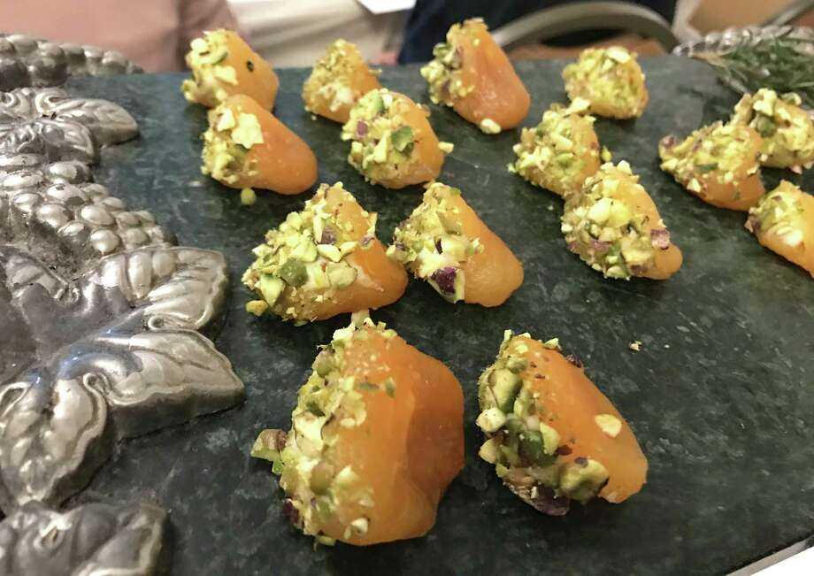 Delicious apricots: We are now craving these cardamom-poached apricots filled with mascarpone and dusted with pistachios, which Georgette Moger-Petraske served during her San Antonio Cocktail Conference seminar on throwing cocktail parties at home. We can't wait to serve them at our next party. Photo: Emily Spicer /San Antonio Express-News