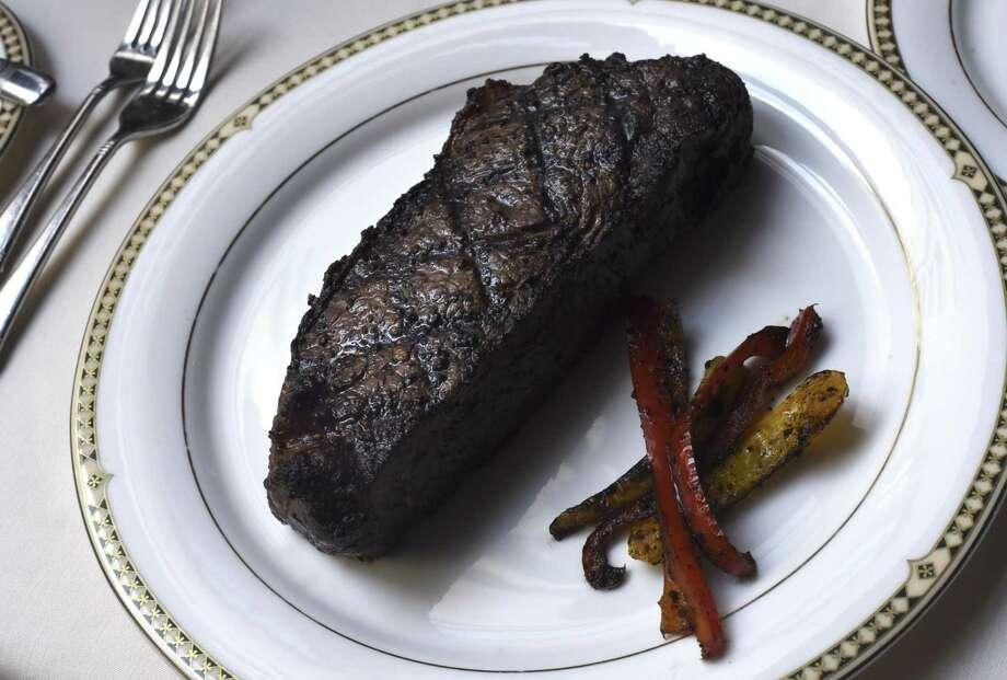 A 16 oz. New York strip steak at Bohanan's. Photo: Billy Calzada /San Antonio Express-News / San Antonio Express-News