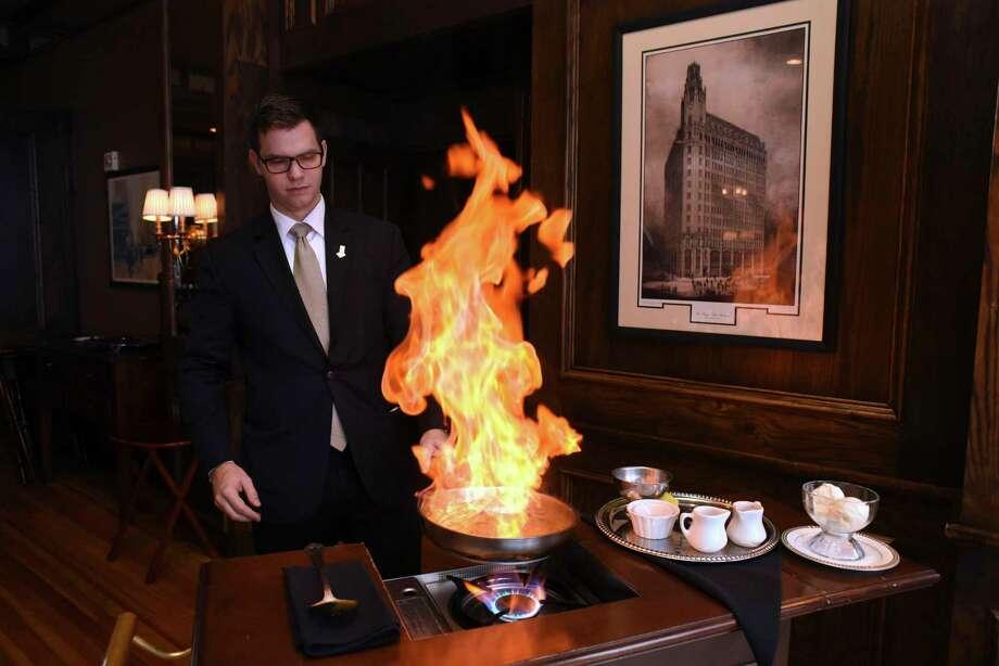 Bohanan's server Peter Mester flames the bananas Foster dessert at Bohanan's. Photo: Billy Calzada /San Antonio Express-News / San Antonio Express-News