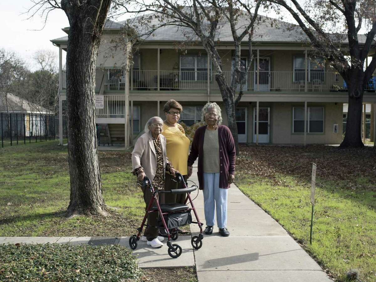 """From left, Eva Mae Jackson, 92, Dorothy Green, 71, and Erma Kidsy, 87, pose for a portrait at Mt. Zion Sheltering Arms, a HUD subsidized retirement community where they live on Tuesday, January 10, 2016 in San Antonio, Texas. All three of the women have sat out in front of their community to watch the Martin Luther King March pass by in years past. """"They pass by thanking us for paving the way for them,"""" Kidsy said. """"We didn't have freedom of speech, but Dr. King showed us that kindness and love will overcome hate...We came a long ways but we still have a way to go."""""""