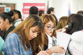 Giselle Rodriguez, Brenda Montalvo and Janelle Zamora fill out an employment application at the TAMIU Student Center Ballroom on Tuesday January 17, 2017 during the Outlet Shoppes Job Fair.