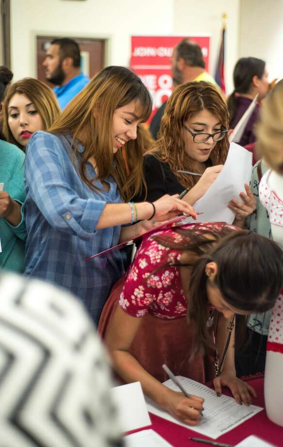 Giselle Rodriguez, Brenda Montalvo and Janelle Zamora fill out an employment application at the TAMIU Student Center Ballroom on Tuesday January 17, 2017 during the Outlet Shoppes Job Fair. Photo: Danny Zaragoza/Danny Zaragoza | Laredo Morning, Danny Zaragoza