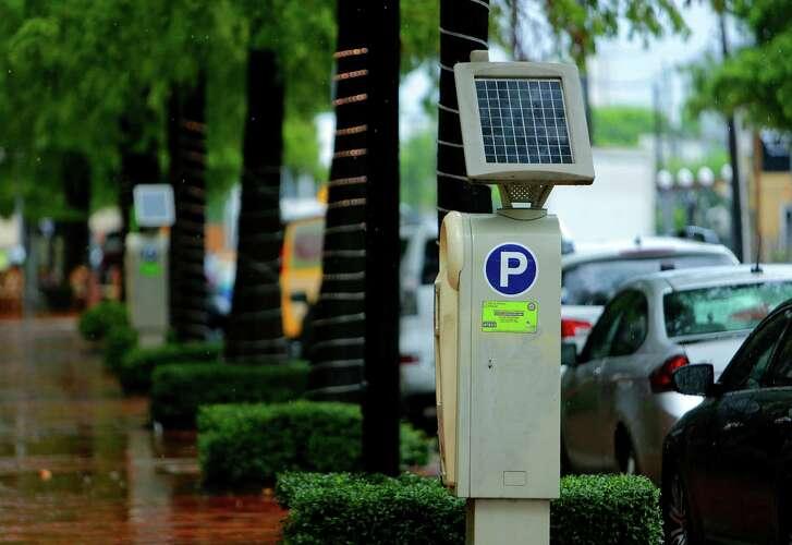 Parking meters line Gray Street just west of Bagby Street in Houston. ( Mark Mulligan / Houston Chronicle )