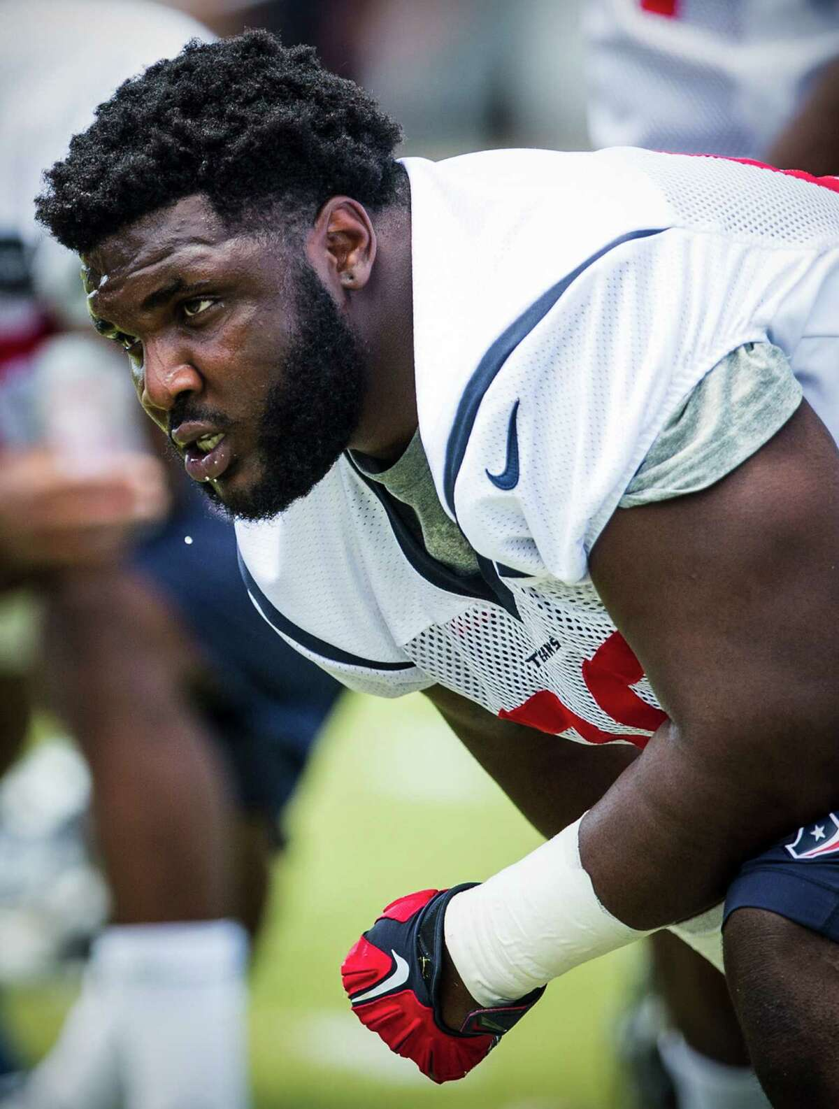 Houston Texans nose tackle D.J. Reader stretches during rookie mini camp at The Methodist Training Center on Saturday, May 7, 2016, in Houston. ( Brett Coomer / Houston Chronicle )