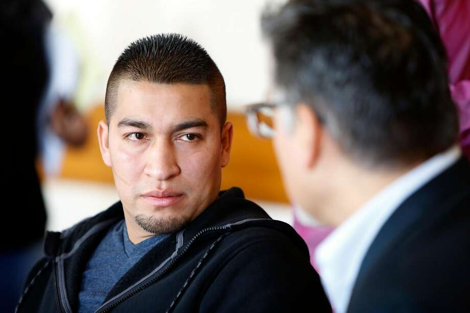 Mission District resident Pedro Figueroa-Zarceno talks about his two-month immigration detention after reporting his car being stolen to police as he talks to Supervisor John Avalos during a enws conference in city hall in San Francisco, California, on Feb. 5, 2016. Photo: Liz Hafalia, The Chronicle