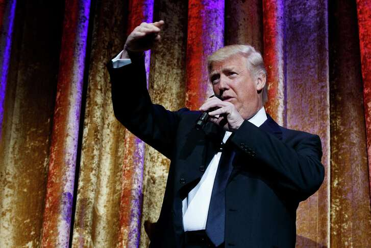 President-elect Donald Trump speaks during the presidential inaugural Chairman's Global Dinner, Tuesday, Jan. 17, 2017, in Washington.