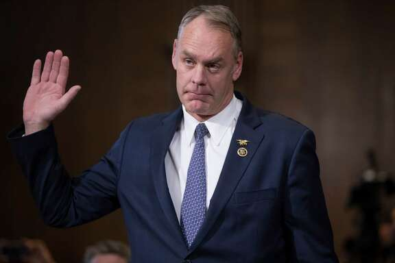 Interior Secretary-designate Ryan Zinke is sworn in on Capitol Hill in Washington, Tuesday, Jan. 17, 2017, prior to testifying at his confirmation hearing before the Senate Energy and Natural Resources Committee. Zinke, 55, a former Navy SEAL who just won his second term in Congress, was an early supporter of President-elect Donald Trump and, like his prospective boss, has expressed skepticism about the urgency of climate change. (AP Photo/J. Scott Applewhite)