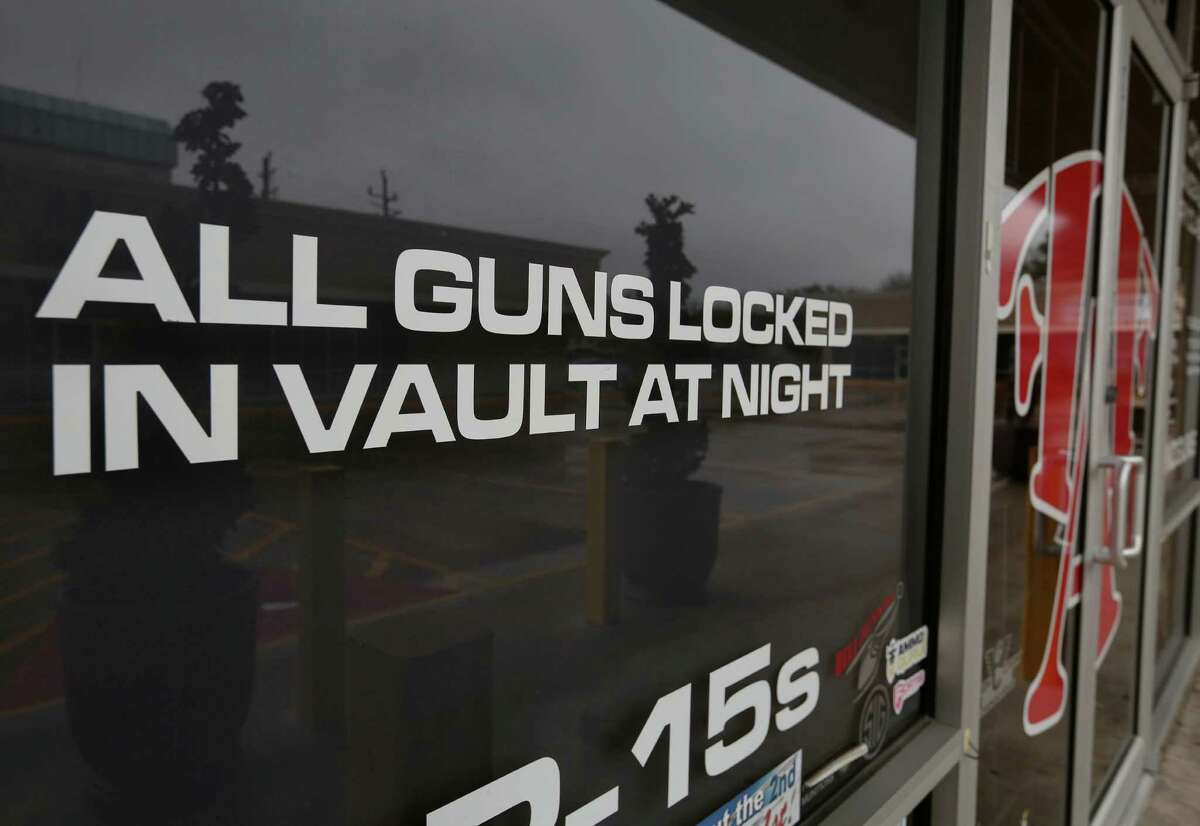 """An attempted burglary happened at Full Armor Gun Range shortly after midnight and two gun shop employees exchanged fire with the suspects Tuesday, Jan. 17, 2017, in Houston. The store has signs reading """"All guns locked in vault at night"""" and """"Brick wall behind glass"""" all over the shop. ( Yi-Chin Lee / Houston Chronicle )"""