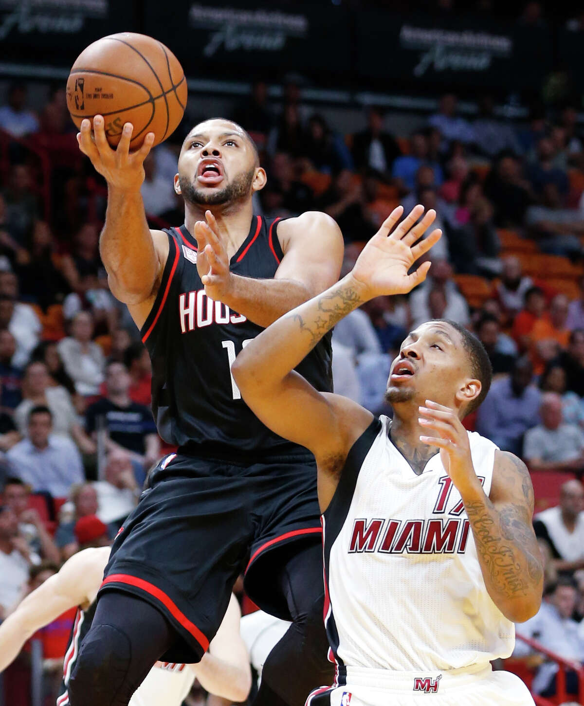 Houston Rockets guard Eric Gordon goes up for a shot against Miami Heat guard Rodney McGruder during the first half of an NBA basketball game, Tuesday, Jan. 17, 2017, in Miami. (AP Photo/Wilfredo Lee)