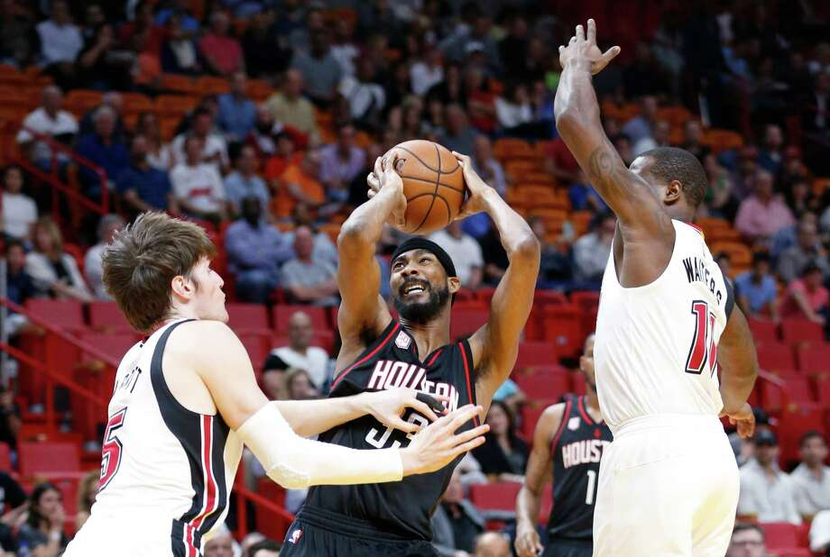Houston Rockets forward Corey Brewer, center, looks for a shot around Miami Heat forward Luke Babbitt, left, and guard Dion Waiters during the first half of an NBA basketball game, Tuesday, Jan. 17, 2017, in Miami. (AP Photo/Wilfredo Lee) Photo: Wilfredo Lee, Associated Press / Copyright 2017 The Associated Press. All rights reserved.