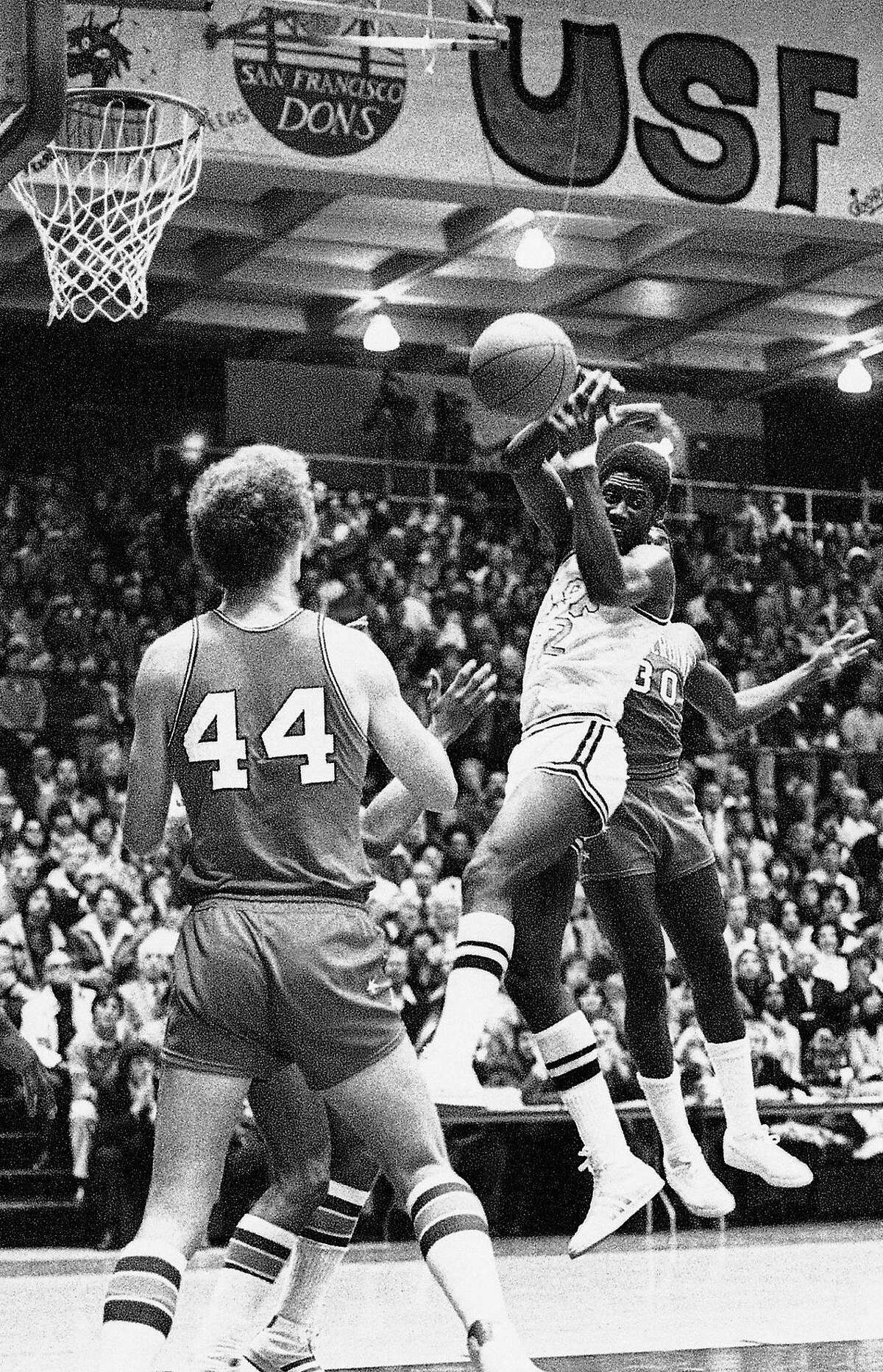 James Hardy (center) averaged 13.4 points and 9.7 rebounds per game in three seasons with USF and played in the NBA.