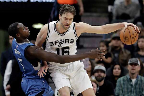 San Antonio Spurs center Pau Gasol (16) is pressured by Minnesota Timberwolves forward Gorgui Dieng (5) during the first half of an NBA basketball game, Tuesday, Jan. 17, 2017, in San Antonio. (AP Photo/Eric Gay)