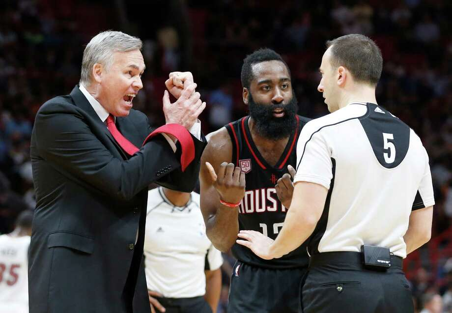 Houston Rockets head coach Mike D'Antoni, left, and guard James Harden argue a call with official Kane Fitzgerald during the second half of an NBA basketball game against the Miami Heat, Tuesday, Jan. 17, 2017, in Miami. The Heat defeated the Rockets 109-103. (AP Photo/Wilfredo Lee) Photo: Wilfredo Lee, STF / Copyright 2017 The Associated Press. All rights reserved.