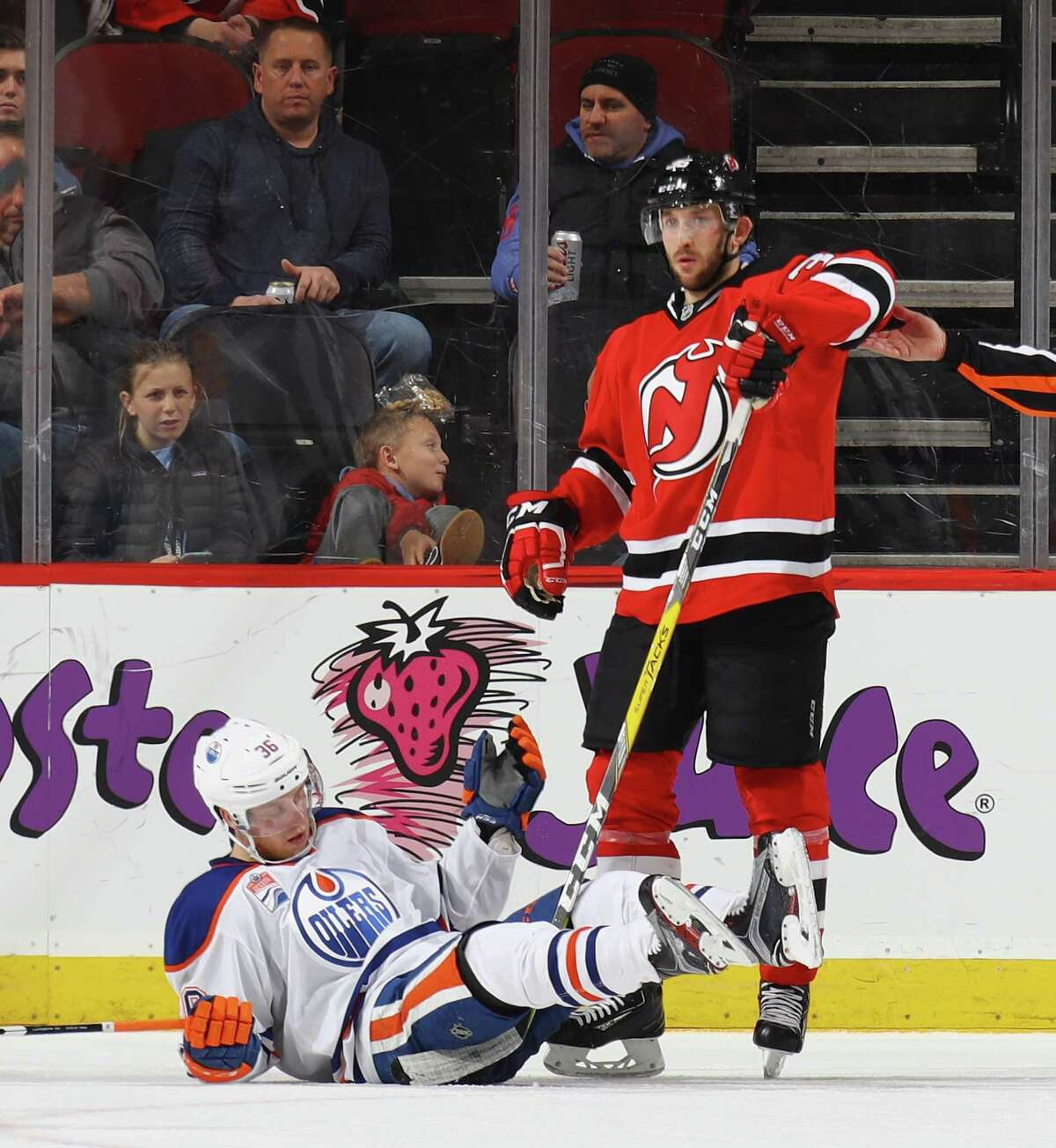 NEWARK, NJ - JANUARY 07: Nick Lappin #36 of the New Jersey Devils trips up Drake Caggiula #36 of the Edmonton Oilers during the second period at the Prudential Center on January 7, 2017 in Newark, New Jersey. (Photo by Bruce Bennett/Getty Images) ORG XMIT: 672872093 ORG XMIT: MER2017010720480658