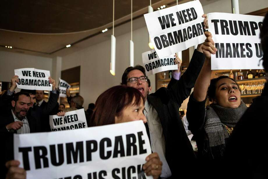 Protesters demonstrate in support of President Barack Obama's health care legislation, in the Jean-Georges restaurant in the Trump International Hotel & Tower at Columbus Circle in New York, Jan. 15, 2017. (Demetrius Freeman/The New York Times) Photo: DEMETRIUS FREEMAN, STR / NYTNS