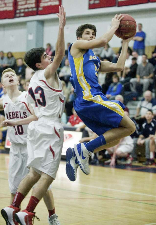 New Fairfield High School's Patrick Martucci tries to stop Brookfield High School's Lucas Joshi in the Candlewood Classic boys basketball tournament played at New Fairfield. Saturday, Dec. 26, 2015 Photo: Scott Mullin / For The / The News-Times Freelance
