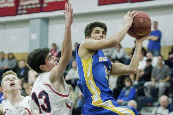 New Fairfield High School's Patrick Martucci tries to stop Brookfield High School's Lucas Joshi in the Candlewood Classic boys basketball tournament played at New Fairfield. Saturday, Dec. 26, 2015