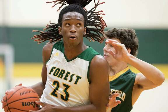 Cedrick Alley (23) of the Klein Forest Golden Eagles eyes the basket prior to going up for a layup against the Stratford Spartans in a high school basketball game on Tuesday, January 17, 2017 at the Klein Forest High School Gym in Houston Texas.