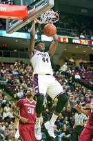 Texas A&M forward Robert Williams (44) dunks during an NCAA college basketball game against Arkansas, Tuesday, Jan. 17, 2017 in College Station, Texas. (Timothy Hurst/College Station Eagle via AP)