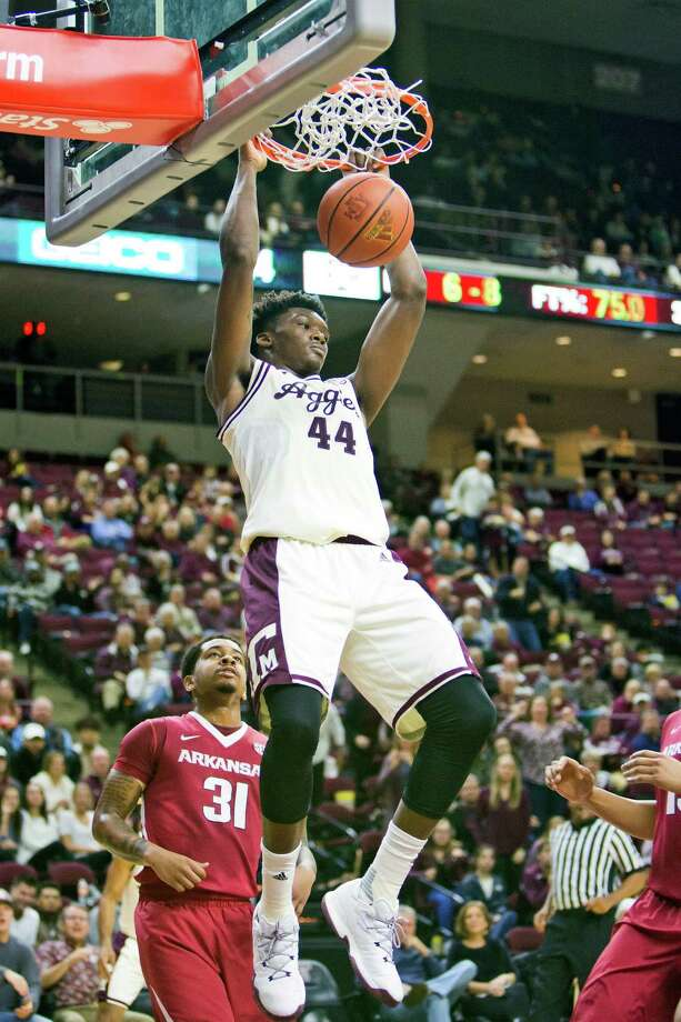 Texas A&M forward Robert Williams (44) dunks during an NCAA college basketball game against Arkansas, Tuesday, Jan. 17, 2017 in College Station, Texas. (Timothy Hurst/College Station Eagle via AP) Photo: Timothy Hurst/The Eagle, Associated Press / The Bryan-College Station Eagle