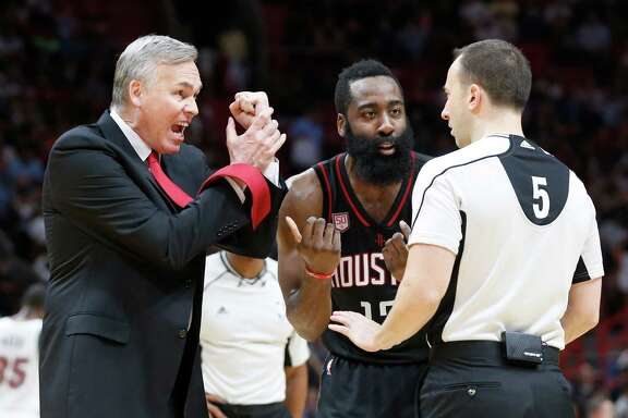 Rockets coach Mike D'Antoni, left, and guard James Harden plead their case to official Kane Fitzgerald.