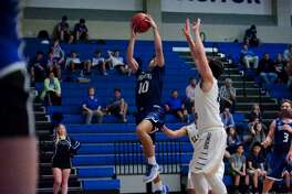 Friendswood's Alex Dehoyos drives to the basket Tuesday night against Clear Springs. Dehoyos scored a game-high 26 points to lead Friendswood to a 68-53 win.