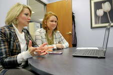 Miriam Dushane, left, managing director  of upstate New York for Linium Recruiting, and Erin Gordon, now a business analyst at Linium, talk with a job candidate for a client via video conferencing  back on Feb. 19, 2015, in Colonie, N.Y.     (Paul Buckowski / Times Union)