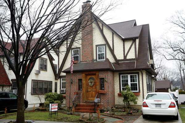 The boyhood home of President-elect Donald Trump, which is going back on the auction block, is shown, Tuesday, Jan. 17, 2017, in New York. Paramount Realty says the 1940 Tudor-style house in Jamaica Estates in Queens is up for auction for the second time in three months, with written bids due Tuesday afternoon.  (AP Photo/Kathy Willens) ORG XMIT: NYKW101