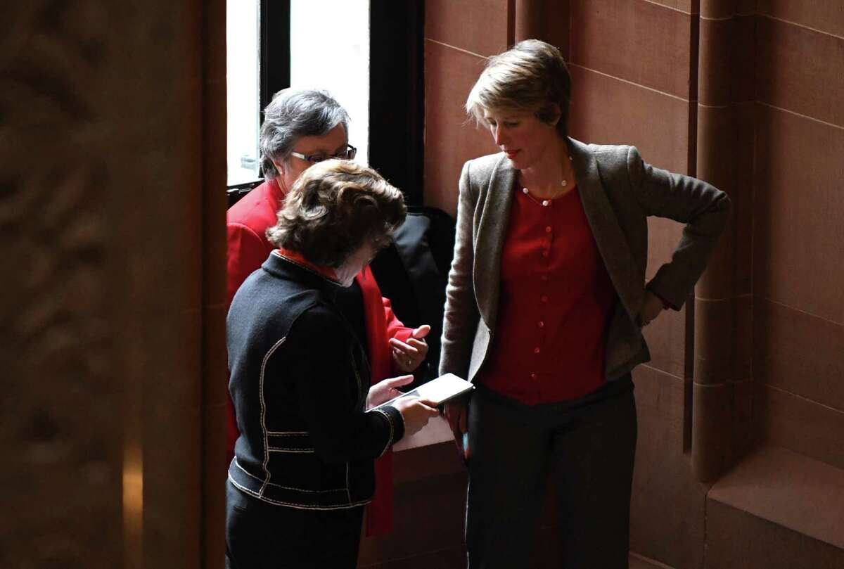 Zephyr Teachout, right, listens to Susan Lerner executive director of Common Cause New York, left background, and Syracuse Mayor Stephanie Miner, foreground, prior to holding a press conference where the trio pitched an ethics reform blueprint plan on Tuesday, Jan. 17, 2017, at the Capitol in Albany, N.Y. (Will Waldron/Times Union)