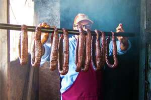 Arthur Yarbough with homemade beef links at Caroline's Quality & Quantity in Kountze