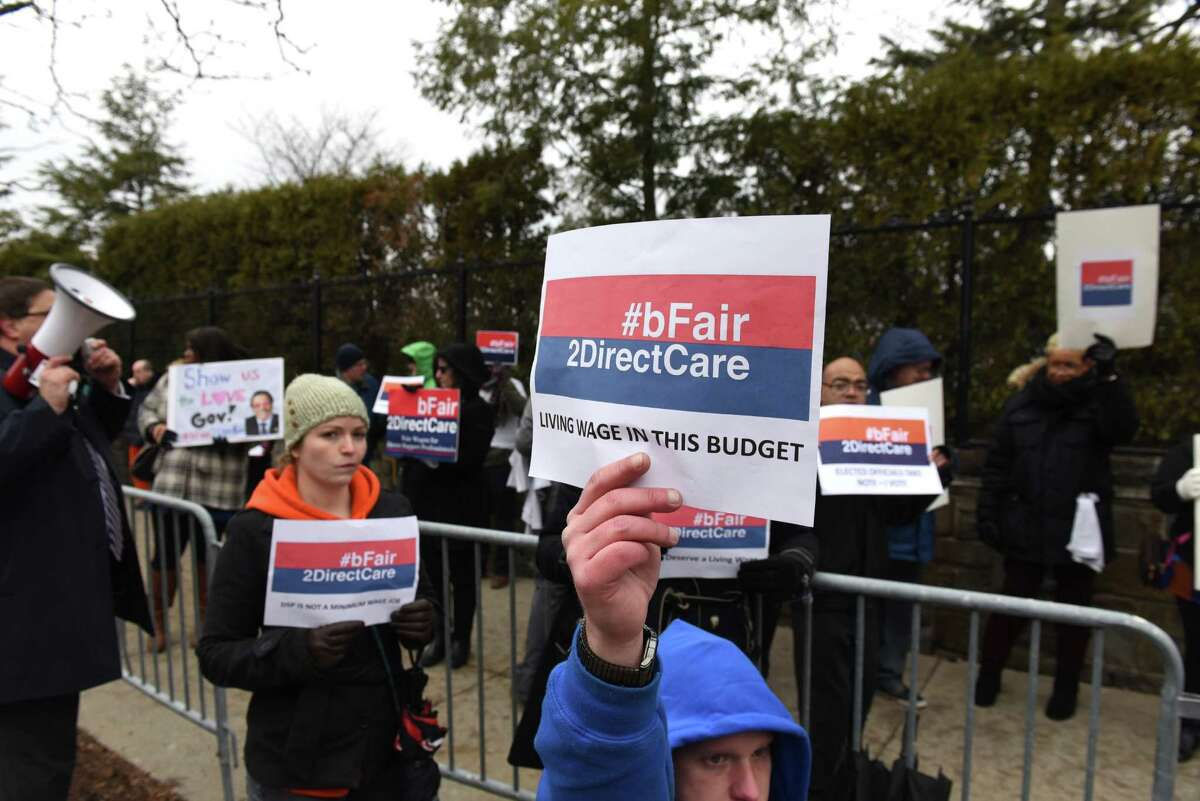 Demonstrators from #bFair2DirectCare rally outside the Executive Mansion in support of budget funding to pay for direct care workers who care for New Yorkers with developmental disabilities on Tuesday, Jan. 17, 2017, in Albany, N.Y. Gov. Cuomo held a private budget briefing with lawmakers at the mansion. (Will Waldron/Times Union)