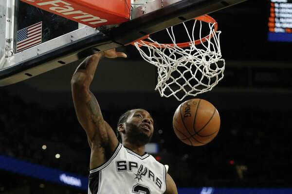 Spurs' Kawhi Leonard (2) gets an unopposed dunk against the Minnesota Timberwolves during their game at the AT&T Center on Jan. 17, 2017.