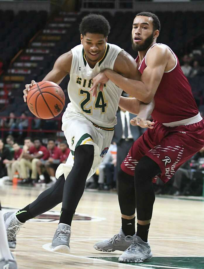 Siena's Lavon Long, left, is defended by Rider's Xavier Lundy during a basketball game at the Times Union Center on Tuesday, Jan. 17, 2017 in Albany, N.Y. (Lori Van Buren / Times Union) Photo: Lori Van Buren / 20039266A